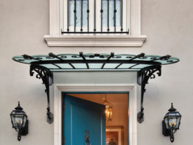 a blue front door with mitered casing in a traditional home exterior design