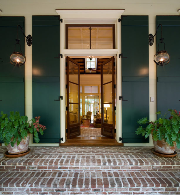 a tall traditional entry with large transom and simple trim that comes with crown