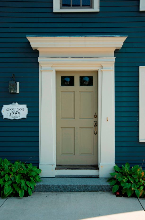 an intricate front door trim with wider size