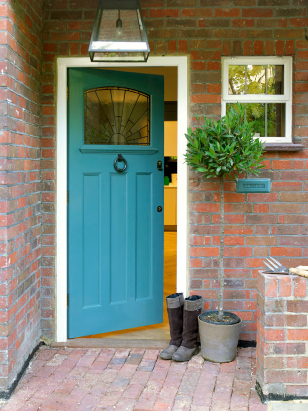 gorgeous cerulean blue front door for red brick house