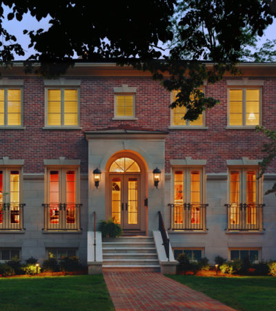 the pairing between red brick and tan accents in an attractive traditional exterior