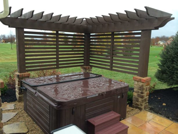 custom arbor to create extra privacy for outdoor hot tub
