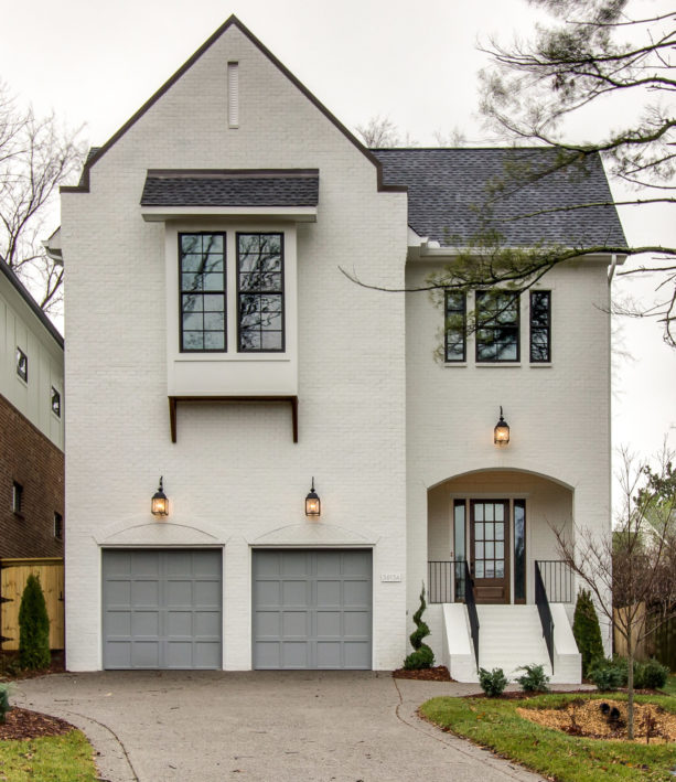 a traditional brick home exterior looks simple yet elegant with white paint
