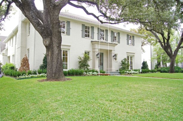 painted brick house exterior with white and grey color scheme