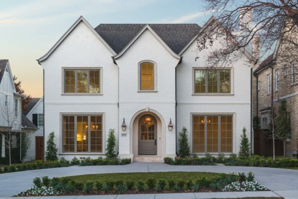 white brick exterior paired with warm grey front door