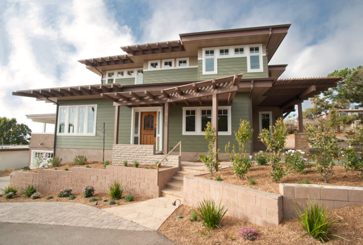 an idea for transitional ranch style design with flat roof and vinyl siding