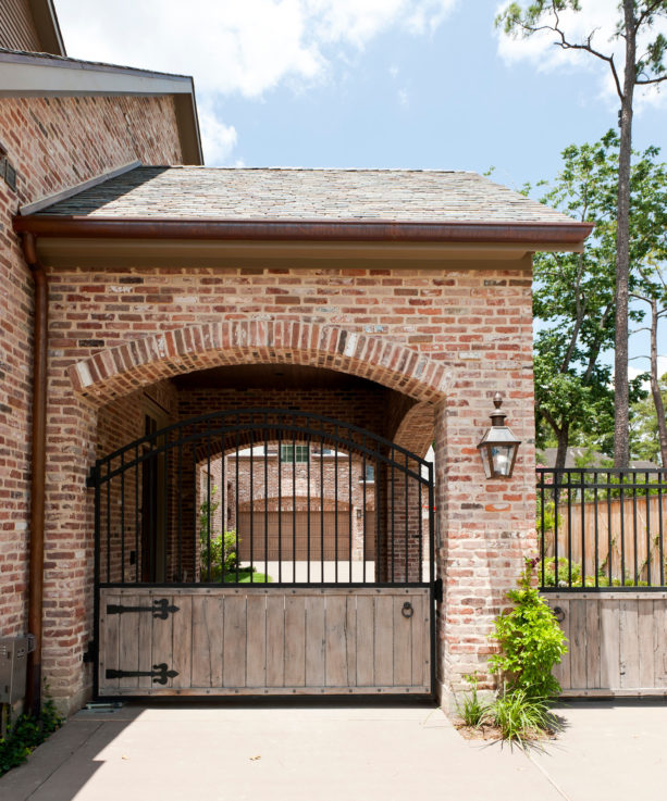 inspiration for a timeless stone carport in front of a detached garage