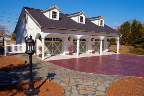 large three-car carport in front of a farmhouse garage