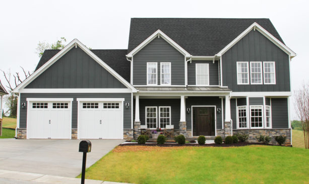 mid-size elegant two-story ranch style house with a lovely vinyl siding