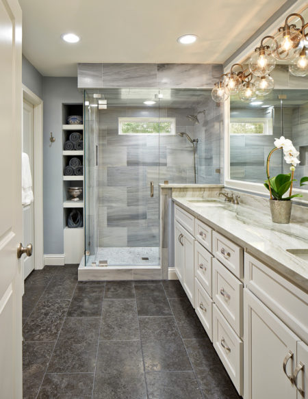 modern master bathroom without tub featuring a long vanity and quartzite countertops