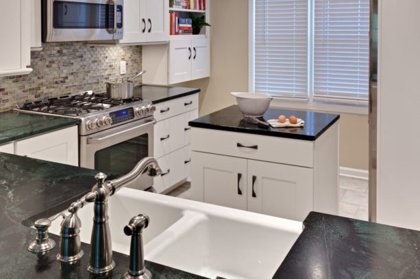 perfect example for classic kitchen for it has white shaker cabinets and wooden black countertops