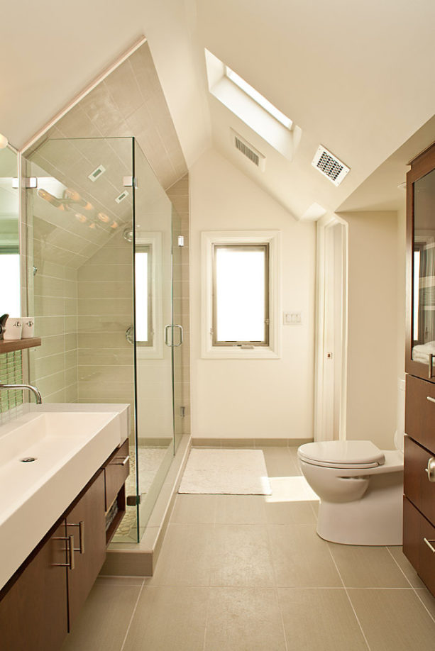 small and trendy master bathroom with a trough sink and without a tub