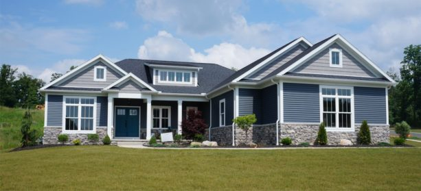 the greystone ranch style home decorated with vinyl siding exterior