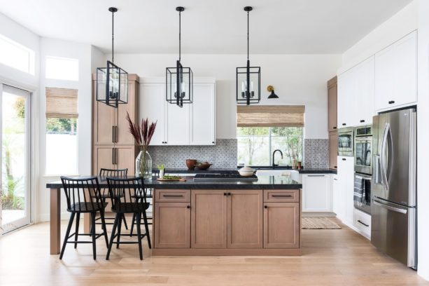 three colored cabinets in white, brown, and black countertops in a transitional kitchen