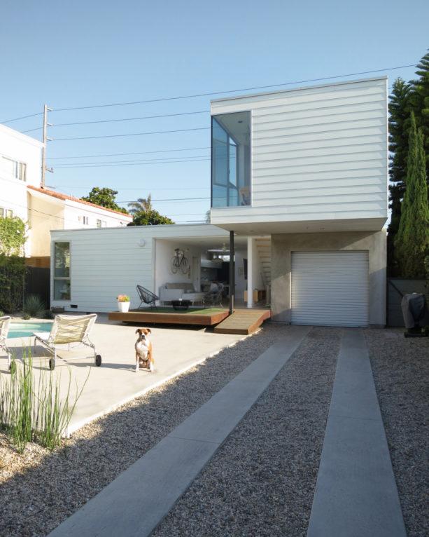 tiny yet chic carport idea with pathway in front of a metal railing door garage