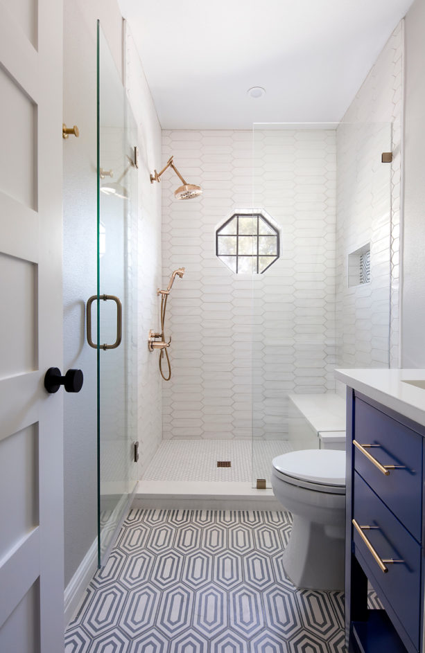 transitional white master bathroom with blue cabinets and without tub