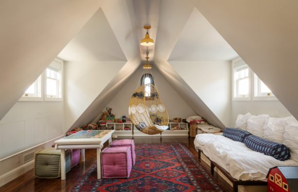 attic bedroom and playroom remodel with slanted walls open to windows
