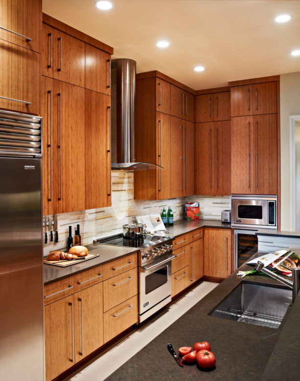 caramelized bamboo floor to ceiling cabinets with stainless steel appliances
