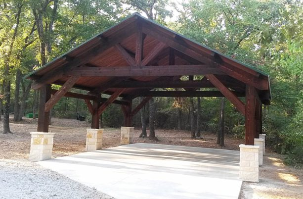 cedar post and beam carport styled as a traditional structure