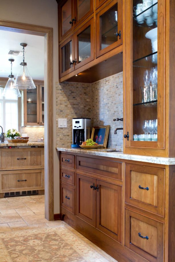 cherry stained natural floor to ceiling cabinets with a clear coat
