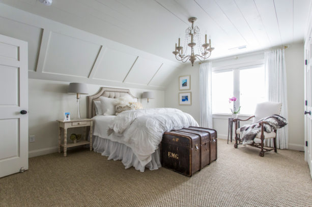 classic extra bedroom in the attic with crisp slanted walls