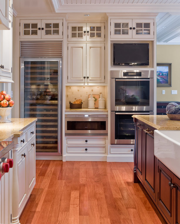 custom-colored beaded inset floor to ceiling cabinets with a brown glaze