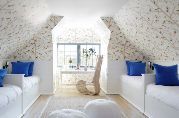 eclectic bedroom in the attic with multicolored slanted walls