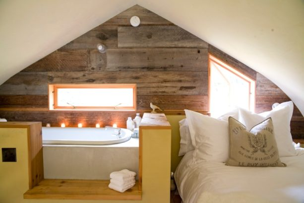extra bedroom in the attic with slanted ceilings and walls with no fireplace