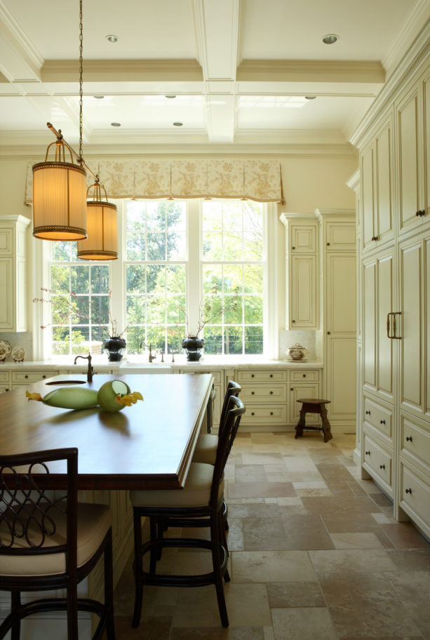 floor to ceiling raised-panel cabinets in benjamin moore mayonnaise color