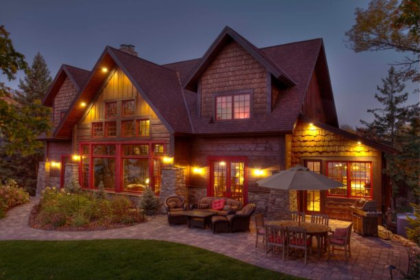 homely two-story wood exterior cabin with marvin wineberry color windows