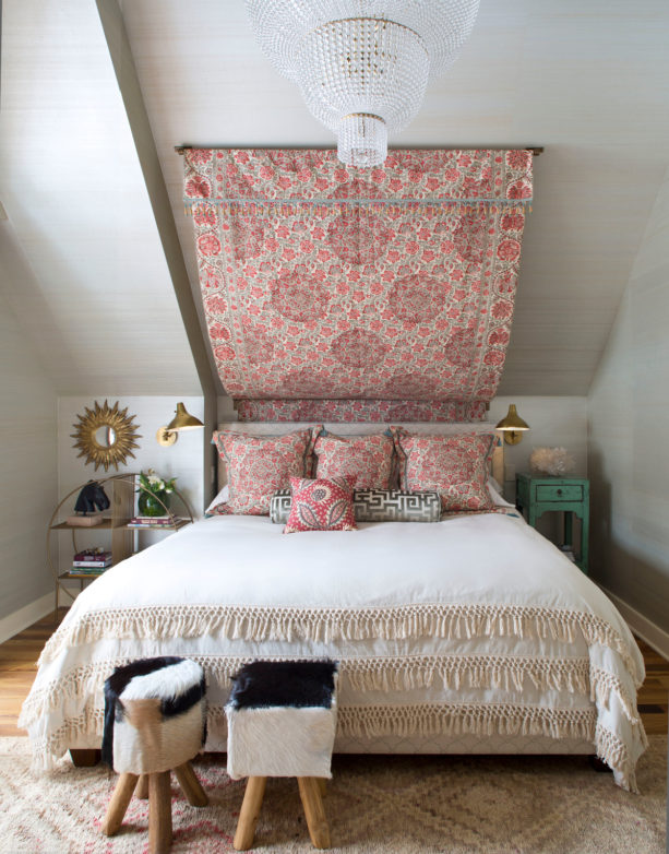 idea for a small yet stylish attic bedroom with light gray slanted walls