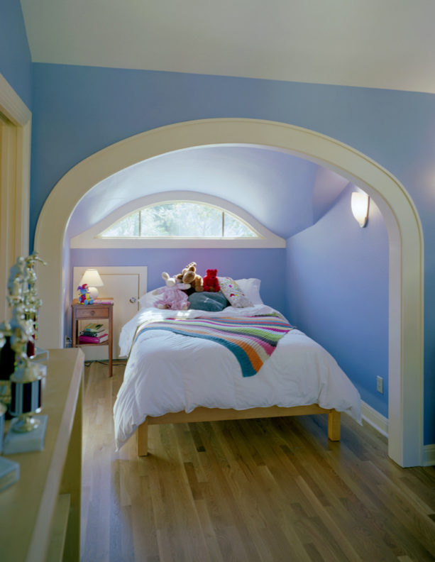 inspiration for a girl's attic bedroom with bright decoration and blue slanted walls
