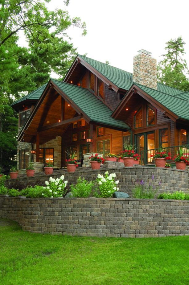 mountain style two story log cabin with shingles in sage green color of metro shakes