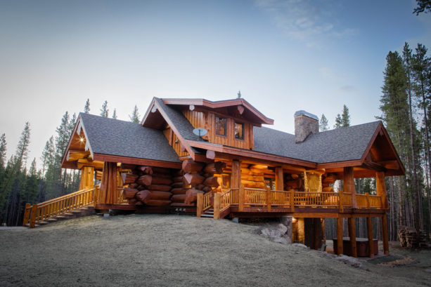 natural oak color stain log cabin exterior with pine siding