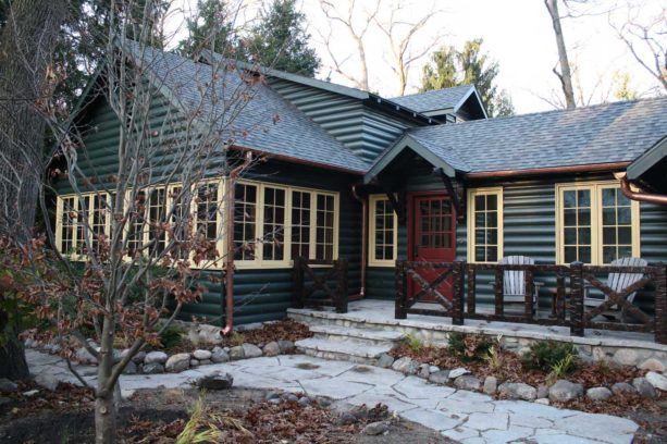 rustic wood exterior log cabin with custom color in benjamin moore paint