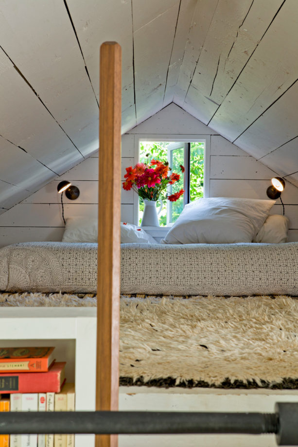 shabby-chic style attic bedroom with natural finish slanted walls
