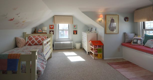 simple girl's bedroom in the attic with low and slanted walls