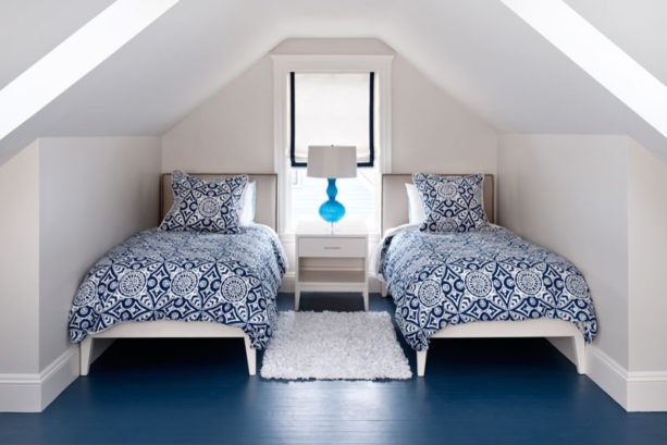 tiny but trendy twin attic bedroom with gray slanted walls
