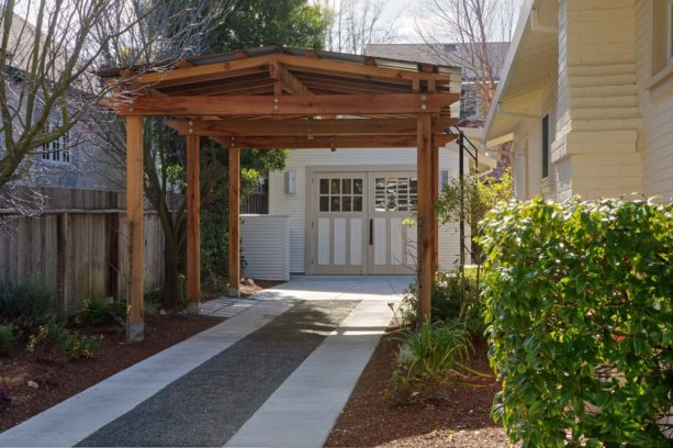 traditional post and beam carport in front of a garage