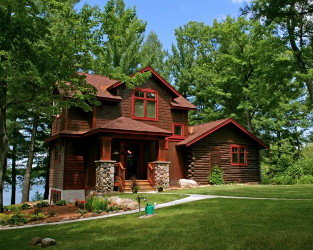 two-story wood log cabin with valspar cherry pickin color for the trim exterior