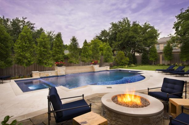 a tuscan stamped concrete and custom-designed pool