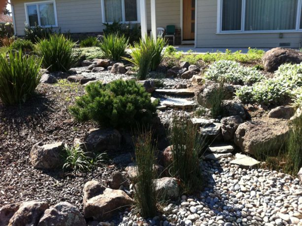 asian style desert backyard with full stone landscaping idea