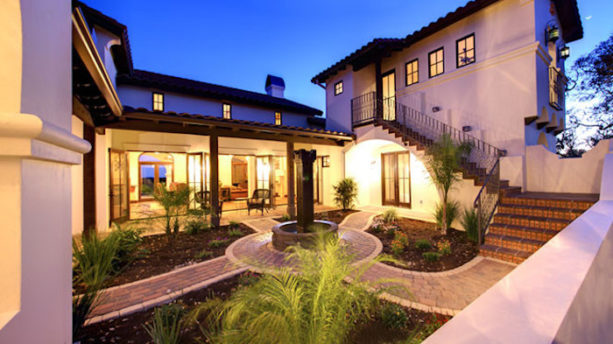 combination of hacienda spanish style and tuscan design home with stone courtyard