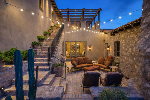 lovely cocktail courtyard in stone exterior spanish style home