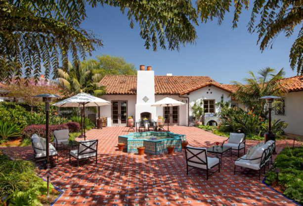 one-story spanish style home completed with a courtyard tile patio