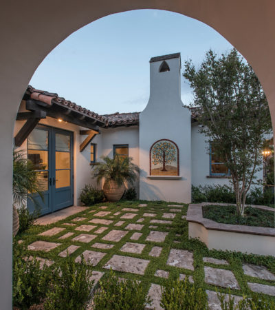 spanish colonial style home featuring a private courtyard