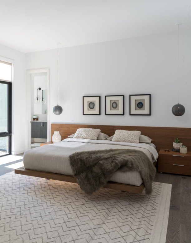 contemporary room with a floating bed in the middle
