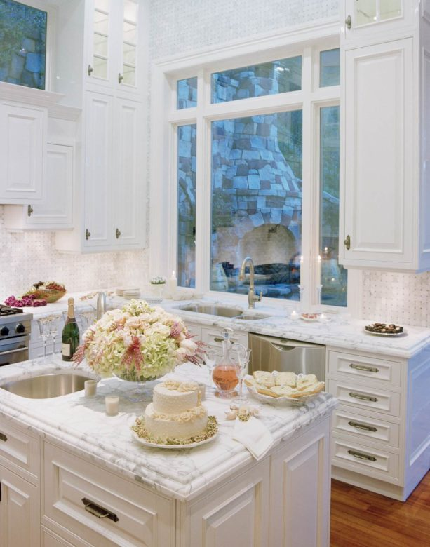 cottage chic kitchen with white picture window over top mount sink