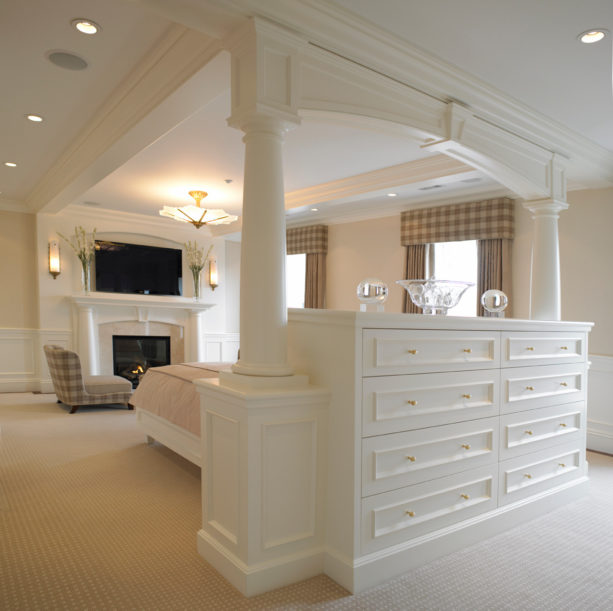 crisp storage bed in the middle of a white traditional room