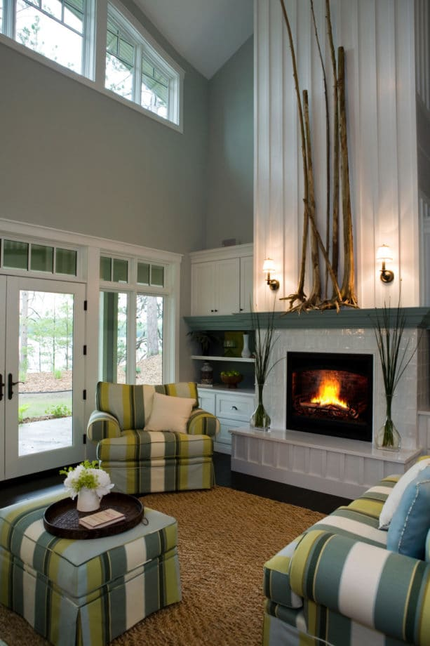 custom shelving and wall unit with custom designed tiled fireplace